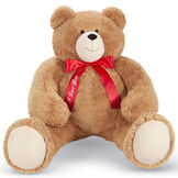 "4' Big Hunka Love Bear with I Love You Bow - Front view of seated golden brown bear dressed in a red satin bow with ""I Love You"" on the right bow tail image number 0"