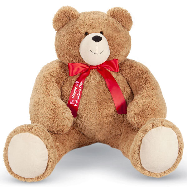 """4' Big Hunka Love Bear with Happy Valentine's Day Bow - Front view of seated golden brown bear dressed in a red satin bow with """"Happy Valentine's Day"""" on the right bow tail image number 0"""