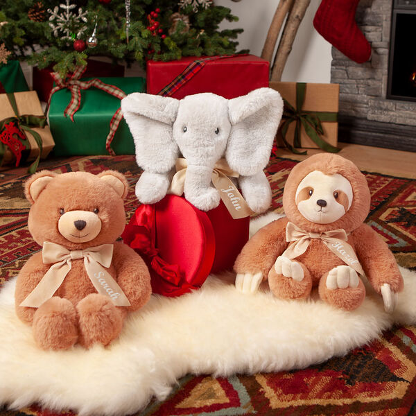 """13"""" Cuddle Cub Sloth with Bow - Bear, Elephant and Sloth sitting on the floor in a Christmas scene image number 1"""