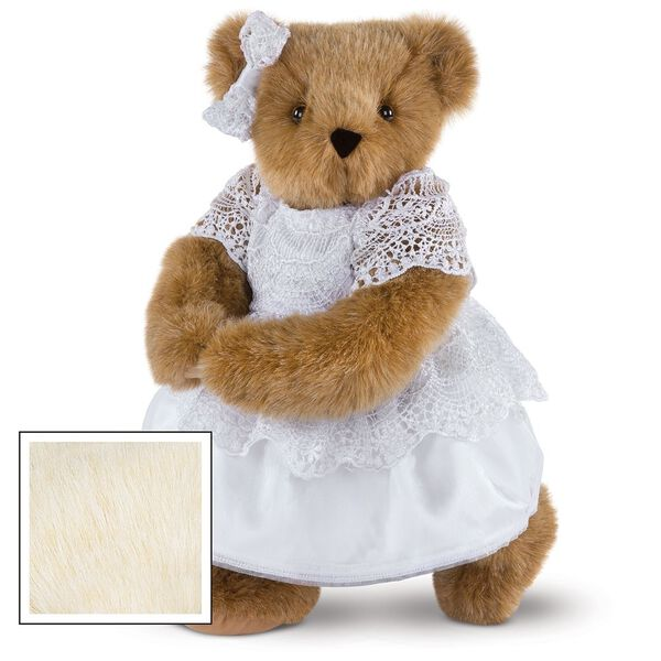 """15"""" Special Occasion Girl Bear - Three quarter view of standing jointed bear dressed in a white satin dress and hair bow with white lace trim - Buttercream brown fur image number 1"""