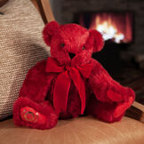 """20"""" Special Edition 40th Anniversary Bear - Seated jointed ruby red bear with red pads and gold Vermont Teddy Bear logo on right foot with red bow in a living room setting image number 0"""