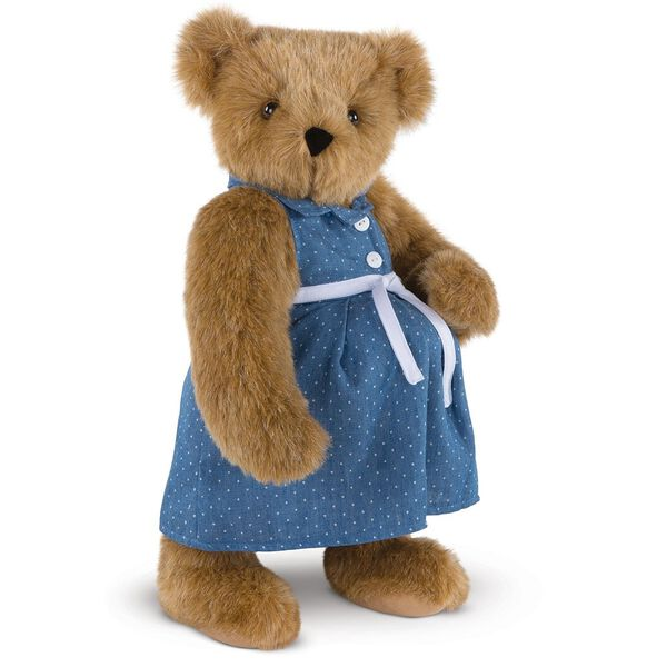 """15"""" Cub in the Oven - Three quarter view of standing pregnant jointed bear dressed in a blue dress with white dots and white belt.  - Honey brown fur image number 0"""