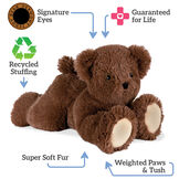 "15"" Belly Bear - Front view of brown Bear lying on its belly. Text surrounding bear read, ""Signature Eyes, Guaranteed For Life, Recycled Stuffing, Super Soft Fur; Weighted Paws and Tush"".  image number 3"