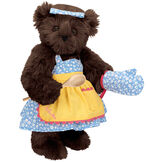"""15"""" Cooking Bear - Three quarter view of standing jointed bear dressed in a blue floral sundress and oven mitt, yellow apron with pink trim and holding a wooden spoon. Apron is personalized with """"Julietta"""" in hot pink - Espresso brown fur image number 7"""