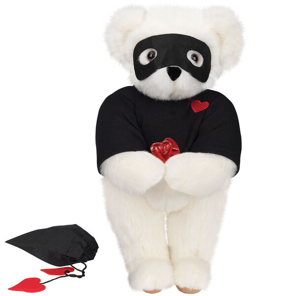 """15"""" Love Bandit Bear - Front view of standing jointed bear dressed in black turtleneck with red heart on left chest, black mask and holding a black bag with 2 chocolates - Vanilla white fur image number 2"""