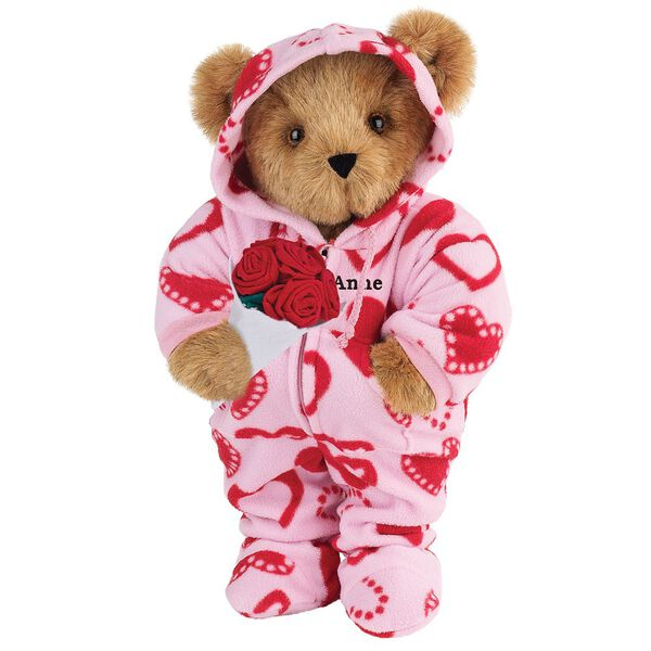 """15"""" Sweetheart Hoodie-Footie Bear with Red Roses - Front view of standing jointed bear dressed in pink hoodie footie with red heart pattern holding a bouquet of red roses, personalized with """"Anne"""" in black on left chest - Honey brown fur image number 0"""