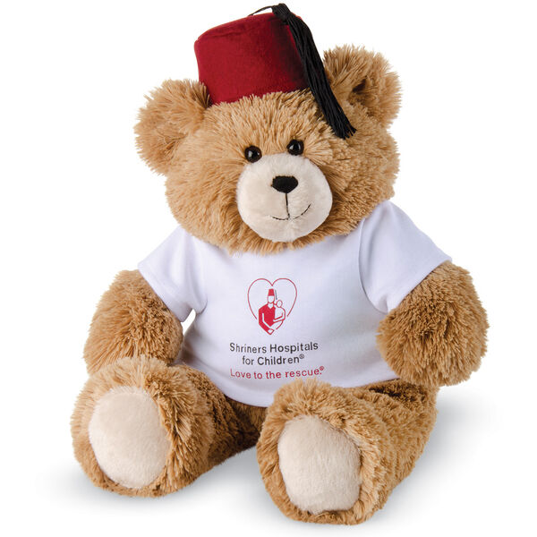 "18"" Love to the rescueandreg; Bear - Front view of seated fuzzy bear with brown eyes, tan muzzle and foot pads, black nose and smile dressed in a maroon Shriners' hat and white t-shirt with ""Shriners Hospital for Kids, Love to the Rescue"" logo image number 0"