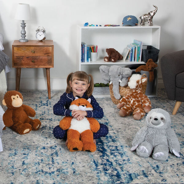 "18"" Oh So Soft Giraffe - 18"" Elephant, 18"" Giraffe, 18"" Sloth, 18"" Monkey, and 18"" Fox sitting on the floor in a bedroom with a child in pajamas image number 7"
