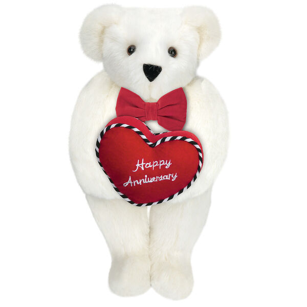 """15"""" Happy Anniversary Bear - Front view of standing jointed bear dressed in a red velvet bow tie and holding a red heart pillow that says' Happy Anniversary"""" in white  - Vanilla white fur image number 2"""