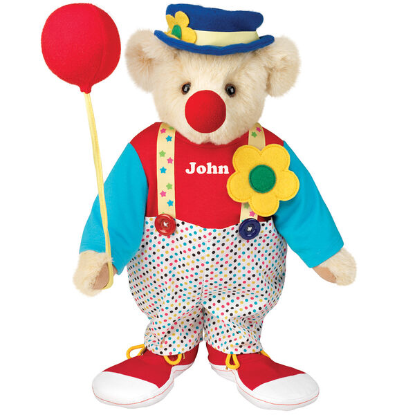 "15"" Clown Bear - Standing jointed bear dressed in dot pants with suspenders and daisy, red and blue shirt, blue hat, red clown shoes, and holds  red fabric balloon made personalized with ""John"" in white on shirt's center front - Buttercream brown fur image number 1"
