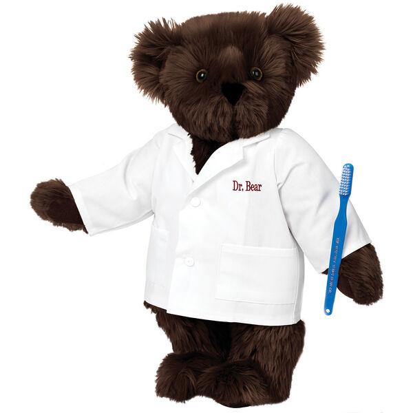 "15"" Dentist Bear - Three quarter view of standing jointed bear dressed in white labcoat and holding a toothbrush, personalized with ""Dr. Bear"" on left chest of coat in red lettering  image number 4"