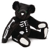 """15"""" Skeleton Bear -  Seated 3/4 view of jointed black bear with glow in the dark eyes and bones white nose and white pads.  image number 1"""