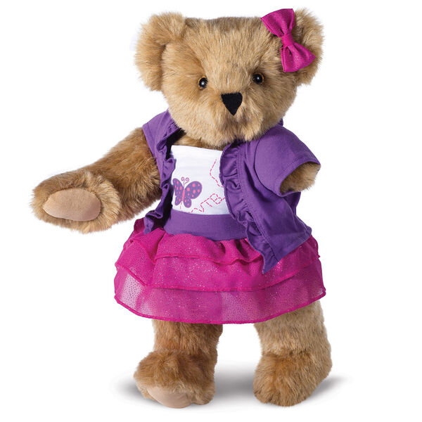 """15"""" Limb Loss and Limb Difference Bear - Three quarter view of standing  jointed bear dressed in a Glitter Whimsy outfit - Honey brown fur image number 1"""