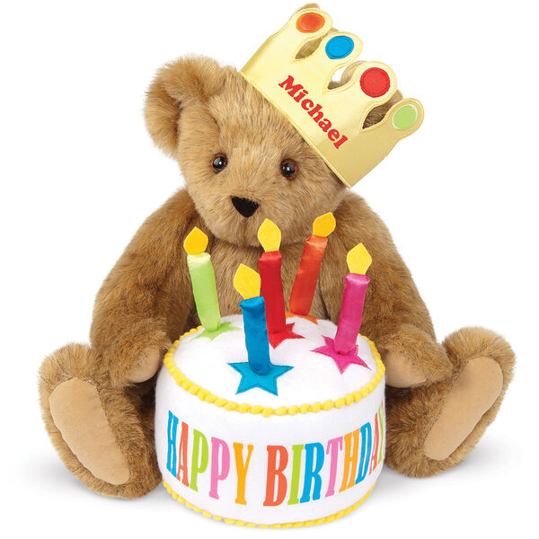 "15"" Happy Birthday Bear - Front view of seated jointed bear dressed in a gold crown with appliqued jewels holding a birthday cake with candles that says ""Happy Birthday"". Crown is personalized with ""Michael"" in red lettering - Honey brown fur image number 0"