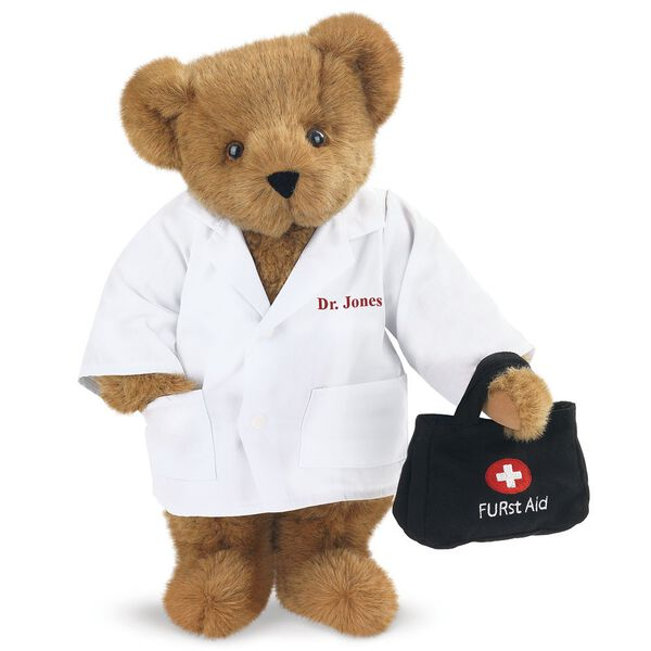 "15"" Doctor Bear - Front view of standing jointed bear dressed in white labcoat holding a doctor bag that is embroidered wth ""FURst Aid"" and a medical cross in red and white personalized with ""Dr. Jones"" on left chest in red - Honey brown fur image number 0"