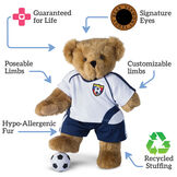 """15"""" Limb Loss and Limb Difference Bear - Standing  jointed bear dressed in Soccer outfit, text reads, """"Signature Eyes; Customizable Limbs; Recycled Stuffing; Poseable Limbs; Hypo-Allergenic Fur; Poseable Limbs; Guaranteed For Life"""".  - Honey brown fur image number 4"""