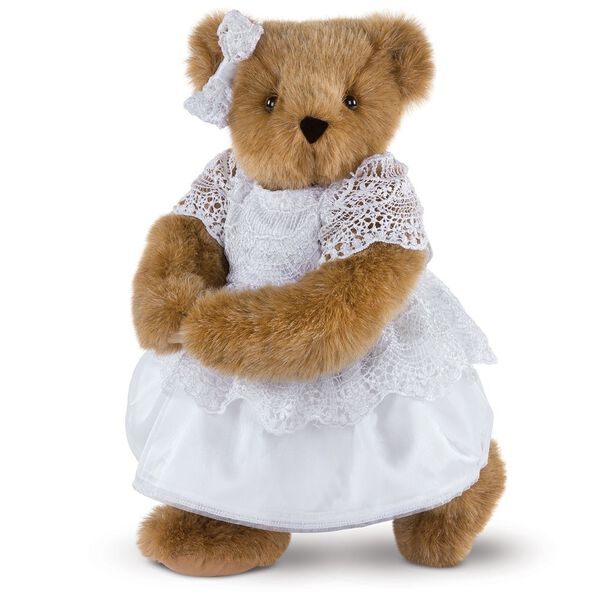 """15"""" Special Occasion Girl Bear - Three quarter view of standing jointed bear dressed in a white satin dress and hair bow with white lace trim - Honey brown fur image number 0"""