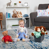 "13"" PJ Pal Llama -  Toddler in striped pajamas playing with PJ Pal Llama. Teddy Bear, Puppy and Monkey are seated in front of bookcase and chair image number 1"