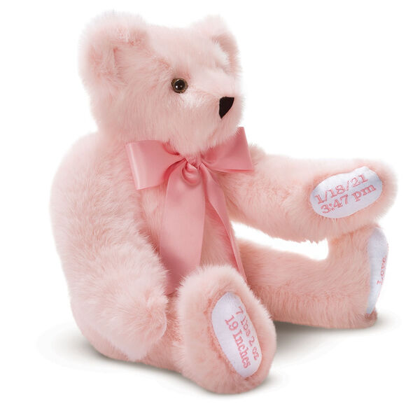 """15"""" Premium Baby Girl Bear - Three quarter view of seated jointed pink bear with white paw pads and chose of eye color wearing a blue satin bow. All 4 paw pads are personalized with baby's name, birth date, pounds and inches at birth.  image number 2"""