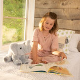 """15"""" Classic Elephant - Three quarter view of seated gray plush elephant in a bedroom scene with a girl model image number 4"""