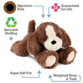 "15"" Belly Puppy Dog - Front view of brown puppy lying on its belly. Text surrounding bear read, ""Signature Eyes, Guaranteed For Life, Recycled Stuffing, Super Soft Fur; Weighted Paws and Tush"".  image number 1"