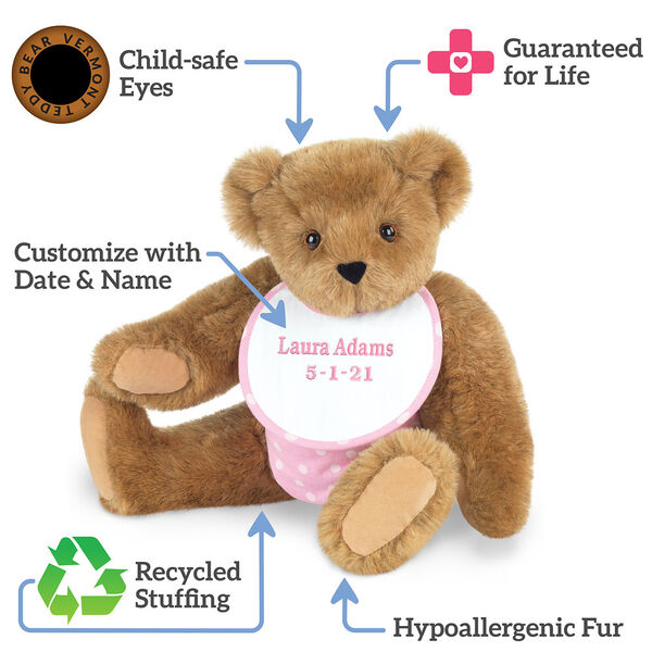 """15"""" Baby Girl Bear - Seated jointed bear dressed in pink with white dots fabric diaper and bib, text around bear reads, """"Guaranteed For Life; Recycled Stuffing; Hypoallergenic Fur; Customize with Date and Name; Child-safe Eyes"""".  image number 1"""