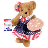 """15"""" Mom for President - Front view of standing jointed bear in a red, white and blue stars and stripes dress with matching head bow, with a """"Mom for President"""" pin holding an apple pie and a voting ballot - Honey brown fur image number 0"""