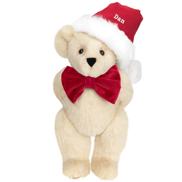 """15"""" Christmas Classic Bear - Standing jointed bear dressed in white red velvet bow tie with red velvet santa hat with white fur trim. Hat is personalized with """"Dan"""" above the fur  - Buttercream brown fur image number 1"""