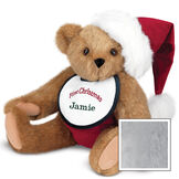 """15"""" Baby's First Christmas Bear - Seated jointed bear dressed in red velvet diaper with santa hat and white and green bib that says ' First Christmas' in red lettering. Bib is personalized with """"Jamie"""" in dark green lettering - Gray image number 4"""