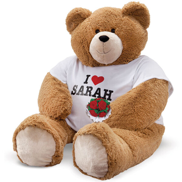 """4' Big Hunka Love """"I HEART You"""" T-Shirt Bear with Roses - Seated floppy 4 foot honey brown bear with brown eyes dressed in a white t-shirt with 'I Heart Sarah' personalized on the front in black and red, holding a bouquet of red velvet roses image number 0"""