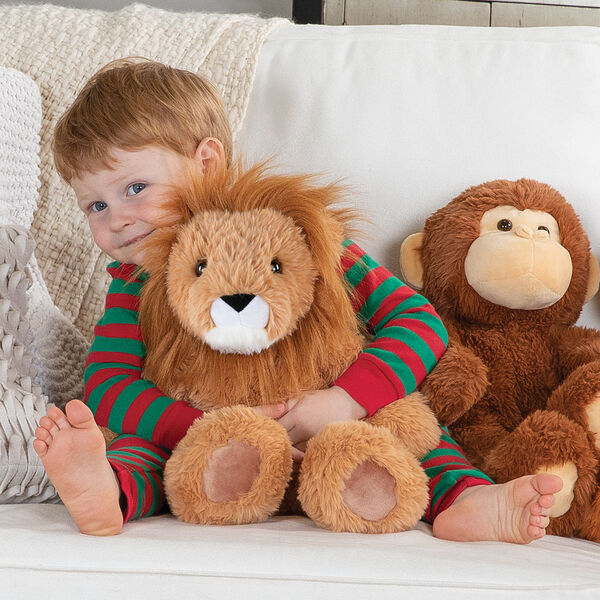 "18"" Oh So Soft Lion - Front view of 18"" Lion and 18"" Monkey being hugged by a boy sitting on a couch image number 3"