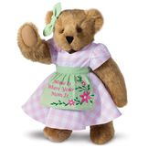 """15"""" Home Is Where Your Mom Is Bear - Front view of standing jointed bear wearing a pink gingham dress, green bow and apron with floral embroidery and says """"Home is Where Your Mom Is"""" - Honey brown fur image number 1"""