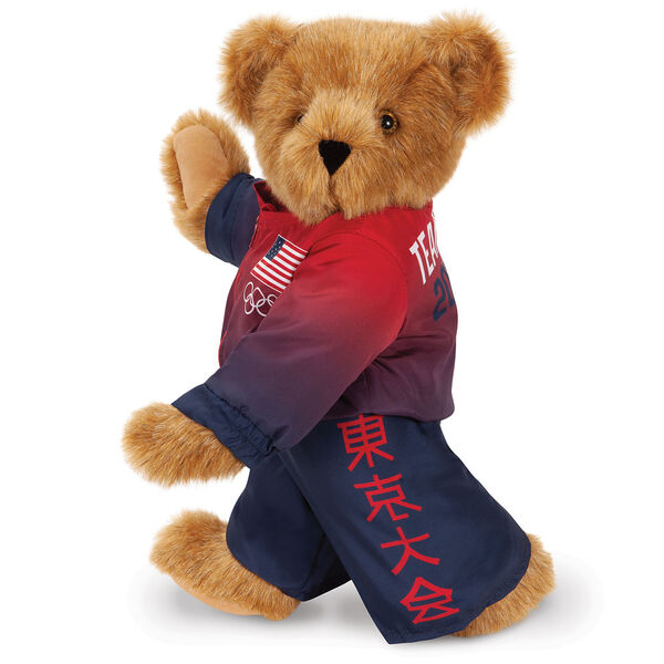"15"" Team USA Olympic Bear - Side View of red and blue track suit with Tokyo Tournament Japanese characters on left pant leg and American flag and Olympic rings on the left chest of the jacket image number 1"