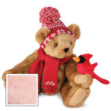"""15"""" Season's Greetings Bear - Front view of seated jointed bear dressed in a knit red and white nordic patterned hat with red scarf and holding a red cardinal. Bottom edge of scarf is personalized with """"Lily"""" in white lettering - Pink image number 5"""