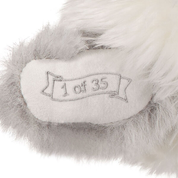 """15"""" Limited Edition Snowflake Santa - close up of bear's right paw with """"1 of 35"""" embroidery image number 4"""