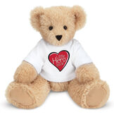 """13"""" Little Hero Bear - Buy 1, Give 1 - Front view of butterscotch light brown bear in white t-shirt with Little Hero Friend for Life Logo image number 0"""
