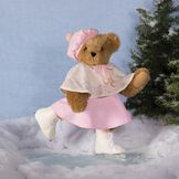 "15"" Bianca Bear - Standing Jointed Bear in Honey Fur dressed in ivory cape with snowflake design, pink skirt and hat and white ice skates. Bear is skating on a frozen pond with snow and fir tree in the back.  image number 1"