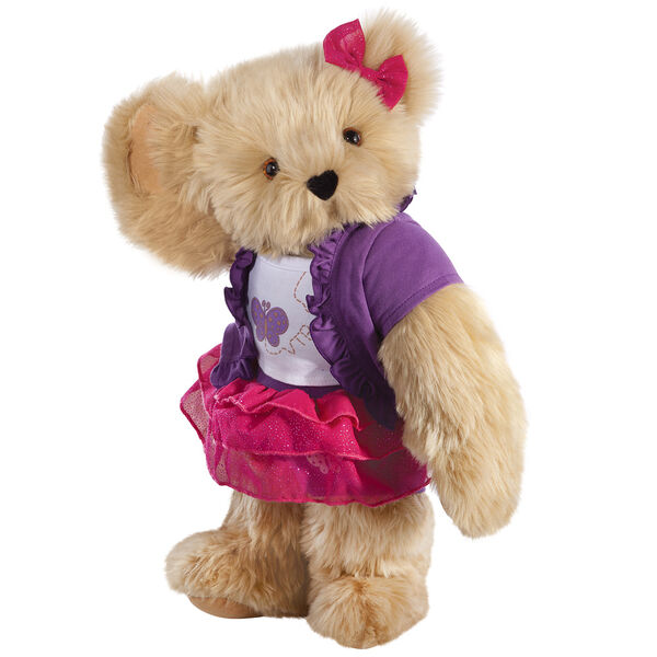 """15"""" Glitter Whimsy Bear - Three quarter view of standing jointed bear dressed in a pink skirt and hair bow, white shirt with butterfly graphic, purple shorts and sweater - Maple brown fur image number 6"""