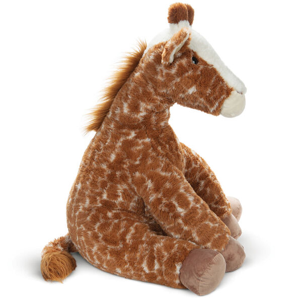 3 1/2' Gentle Giant Giraffe - Side view of seated soft giraffe image number 1