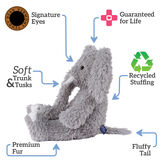 """18"""" Oh So Soft Elephant - Side view of seated gray Elephant with gray foot pads and white tusks and toe nails text reads """"Signature Eyes; Guaranteed For Life; Recycled Stuffing; Fluffy Tail; Premium Fur; Soft Trunk and Tusks"""".  image number 1"""