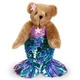 """15"""" Mermaid Bear - Front view of standing jointed bear dressed in a blue sequin tail and purple top with shell embroidery an pink starfish applique and earpiece - honey brown fur image number 11"""