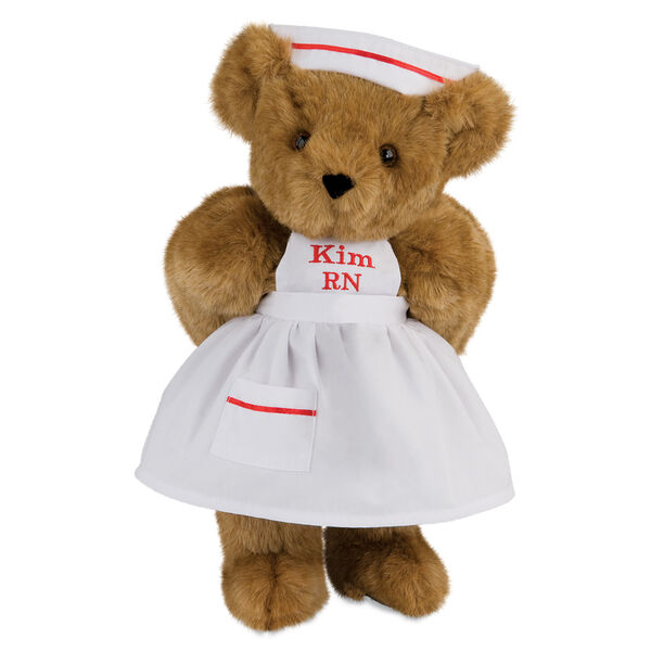 """15"""" Nurse Bear - Front view of standing jointed bear dressed in white nurse's dress and hat with red trim perosnlized with """"Kim RN"""" on bib of dress in red - Honey brown fur image number 0"""