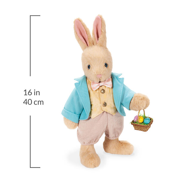 """16"""" Limited Edition Easter Bunny - Front view of Jointed Standing Buttercream Rabbit in a turquoise jacket, yellow vest with bow tie, tan knickers holding an Easter basket with eggs. Measurement of 16 in or 40 cm image number 5"""