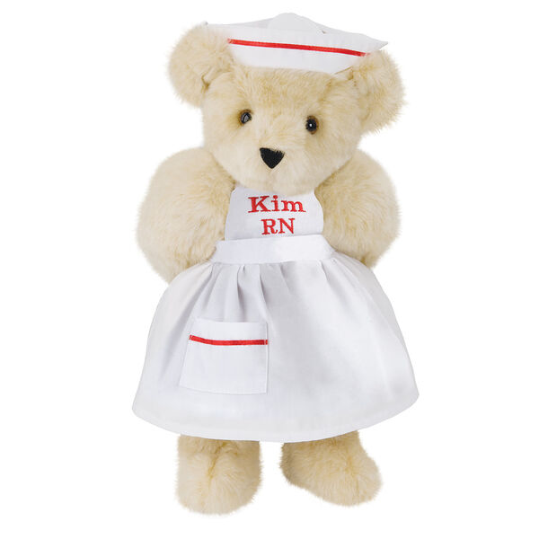 """15"""" Nurse Bear - Front view of standing jointed bear dressed in white nurse's dress and hat with red trim perosnlized with """"Kim RN"""" on bib of dress in red - Buttercream brown fur image number 1"""