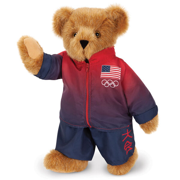 "15"" Team USA Olympic Bear - Front View of red and blue track suit with Tokyo Tournament Japanese characters on left pant leg and American flag and Olympic rings on the left chest of the jacket image number 2"