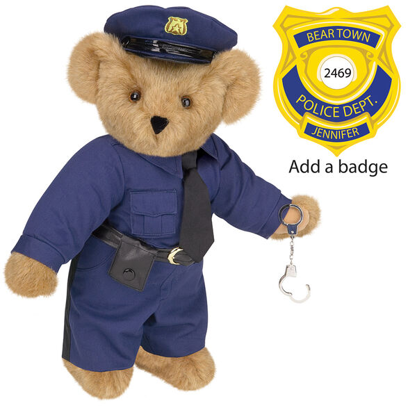 "15"" Police Officer Bear - Three quarter view of standing jointed bear dressed in a nacy blue police uniform with shirt, pants, black tie and hat and holding handcuffs. Personalize with a Police badge - Honey brown fur image number 0"