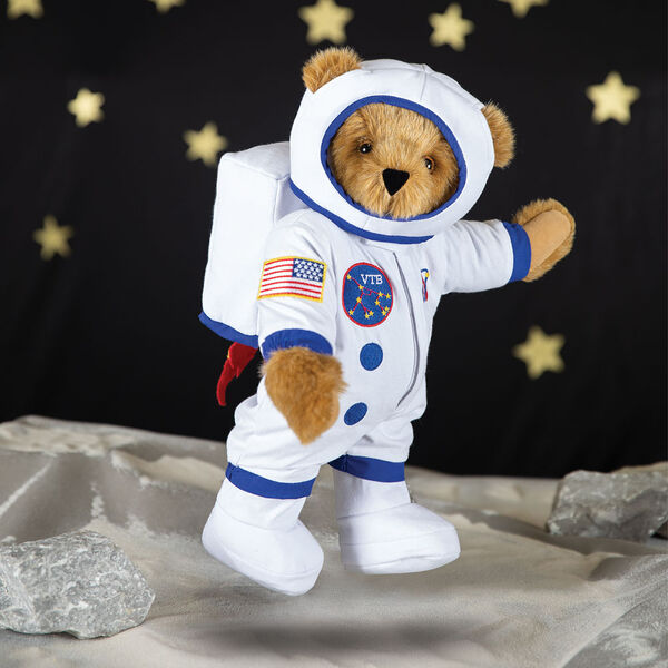 """15"""" Astronaut Bear - Three quarter view of standing jointed bear dressed in white space suit, boots, jet pack and helmet with blue trim, embroidered patches bouncing on the moon - Honey brown fur image number 2"""