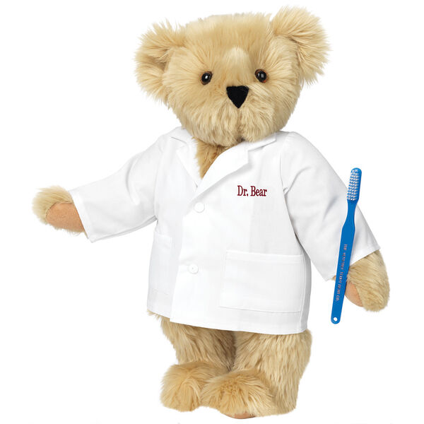 "15"" Dentist Bear - Three quarter view of standing jointed bear dressed in white labcoat and holding a toothbrush, personalized with ""Dr. Bear"" on left chest of coat in red lettering  image number 3"