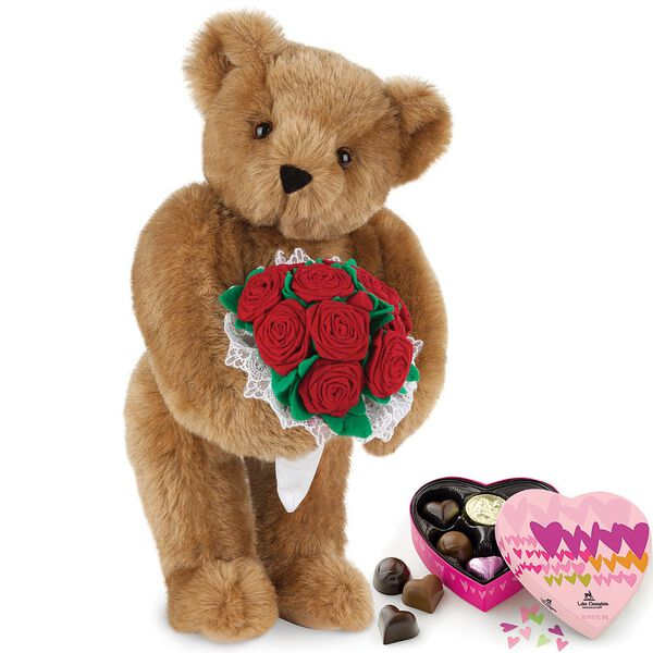 """15"""" Red Rose Bouquet Bear and Chocolates - Front view of standing jointed bear holding a large red bouquet wrapped in white satin and lace  and 6 pc. heart box of chocolates image number 0"""