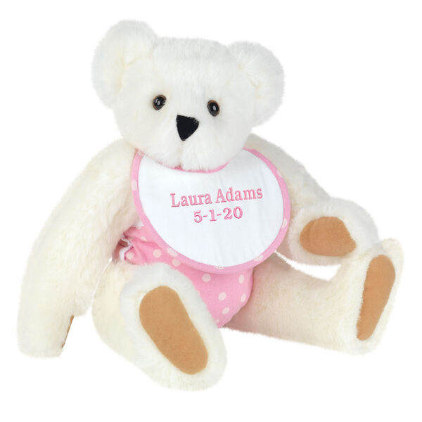 "15"" Baby Girl Bear - Seated jointed bear dressed in pink with white dots fabric diaper and bib. Bib with ""Laura Adams"" and ""5-1-20"" in light pink lettering - Vanilla white fur image number 2"